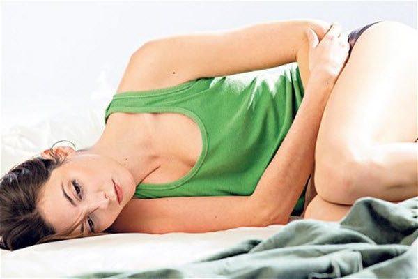 почему возникают менструальные боли в животе